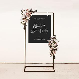 moody wedding welcome sign with calligraphy and modern lettering in black and white