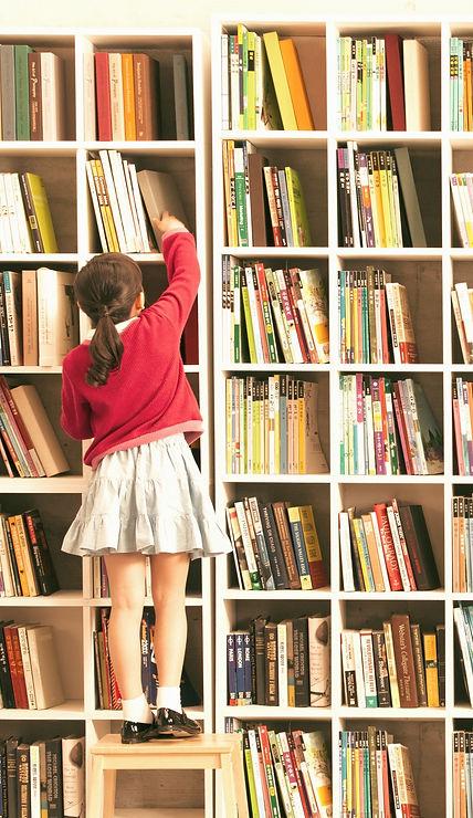 Girl with Bookshelves_edited_edited.jpg