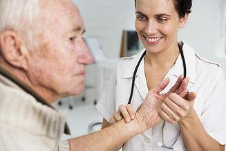 Speech Pathology   Docor Taking Pulse of Older, Male Patiet   PatCom Medical