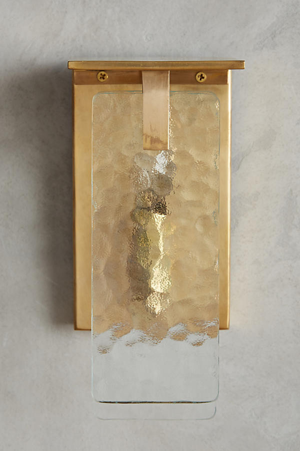 Wall light - Sheets of rippled glass are hung from a brass fixture
