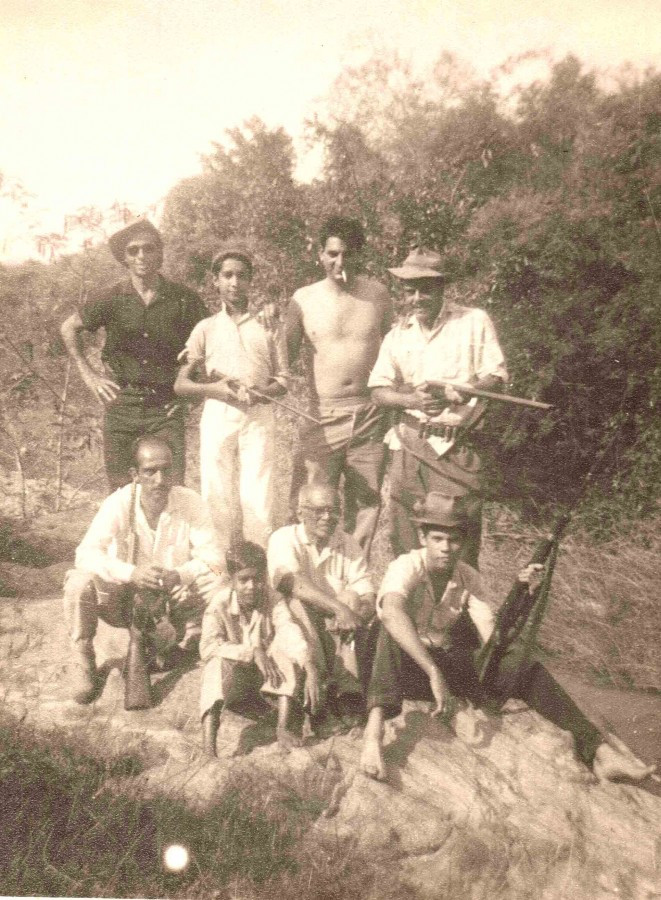 DA in back row without shirt, uncle Gilly bottom right with gun