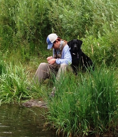 My son, Craig, fly fishing with Ellie, our labrador retriever.