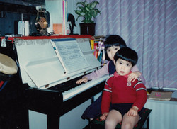 sister and brother with piano