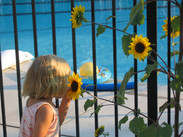 NC Coho girl with pool, flowers.JPG