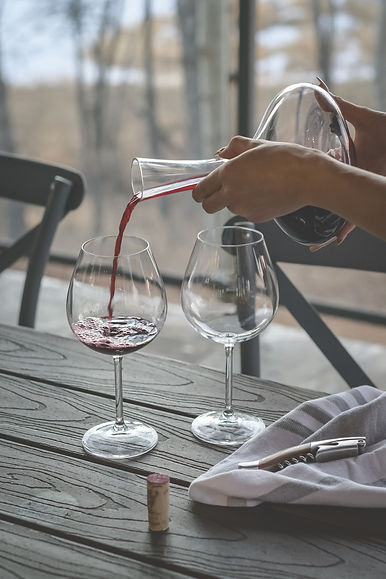 Pouring%20wine%20into%20glass%20from%20a