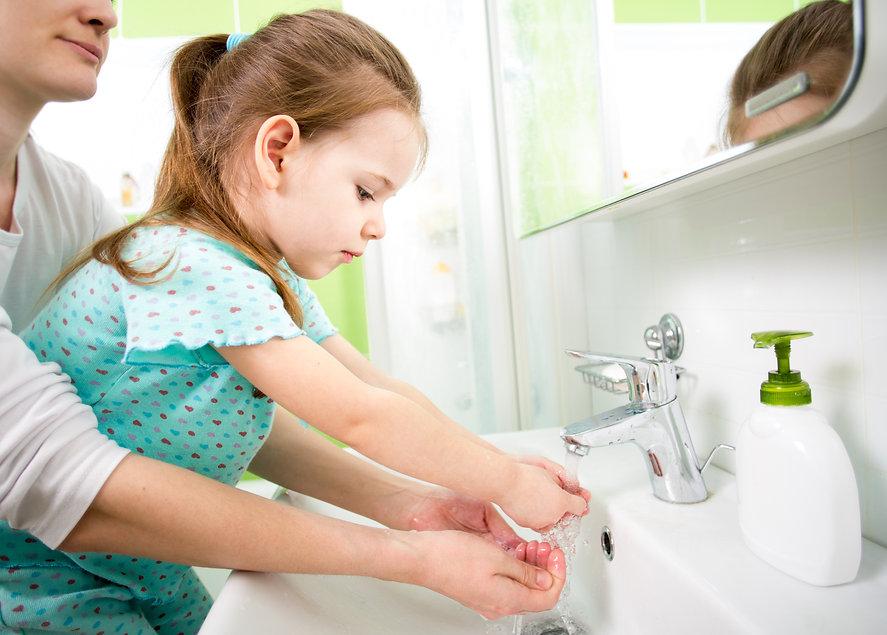 kid washing hands with mom.jpg