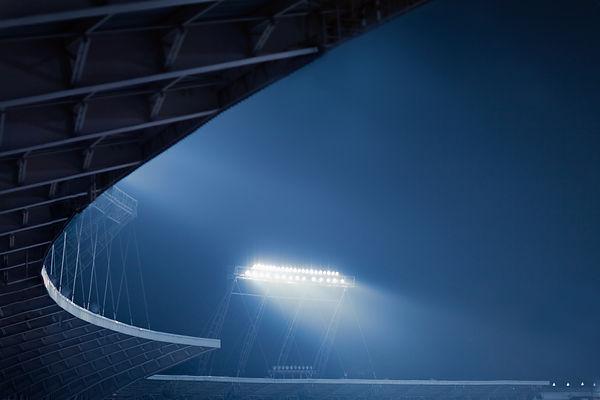 view-of-stadium-lights-at-night-PVZ8AAT.