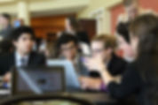 Students working at a conference