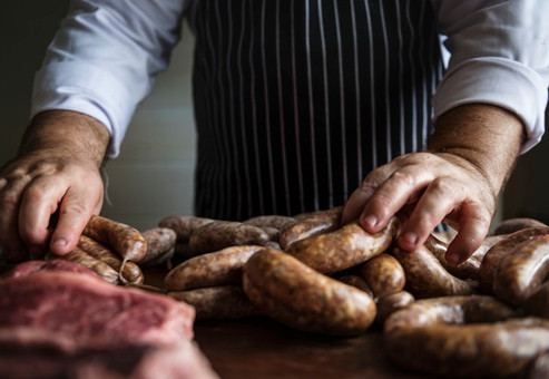 chef-preparing-sausages-food-photography