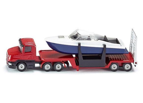Camion avec châssis surbaissé transportant un bateau - SIKU
