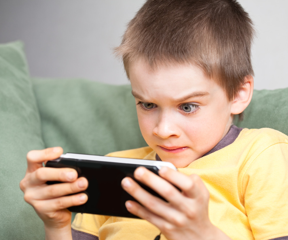 Anxious kid playing video games
