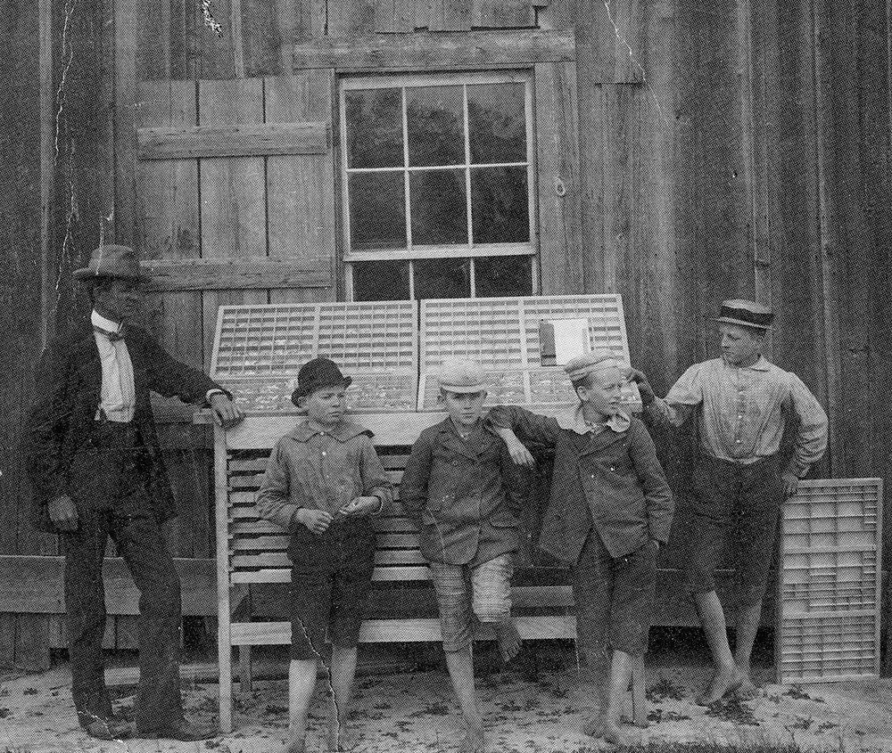 Early 20th Century photo of Connie Maxwell boys who worked at the print shop.