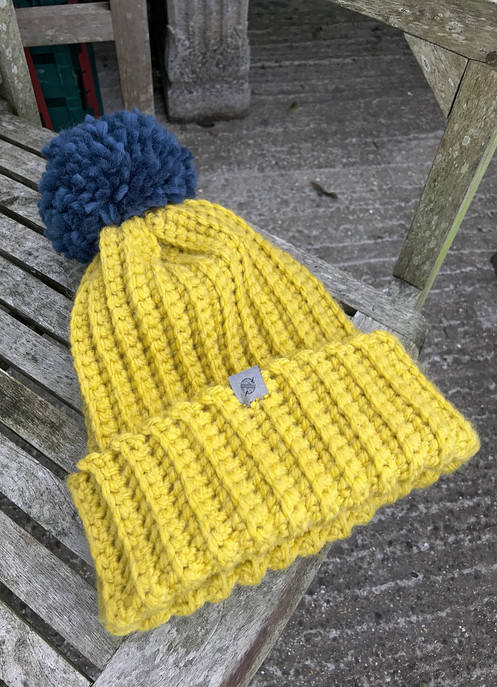 2e9bf785f88 A handmade gorgeous mustard yellow winter bobble hat with blue pom pom and  main body is made from Wendy with wool super chunky yarn which is an  acrylic wool ...