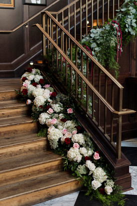 Flower adorned staircase at Oxford Exchange