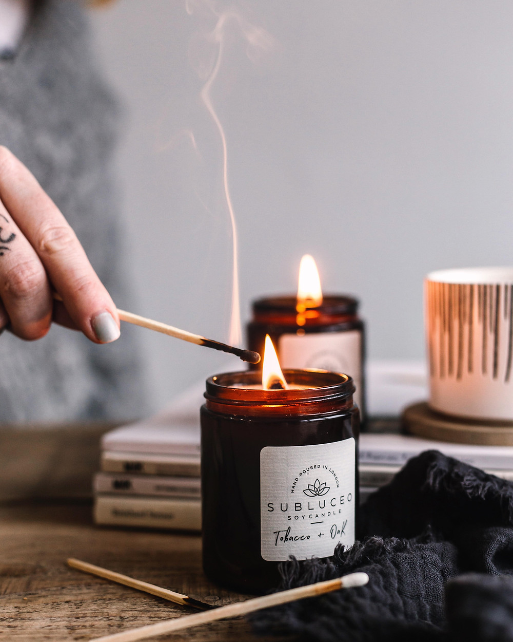 Subluceo zero waste soy candles burning featured in the sustainable collective blog