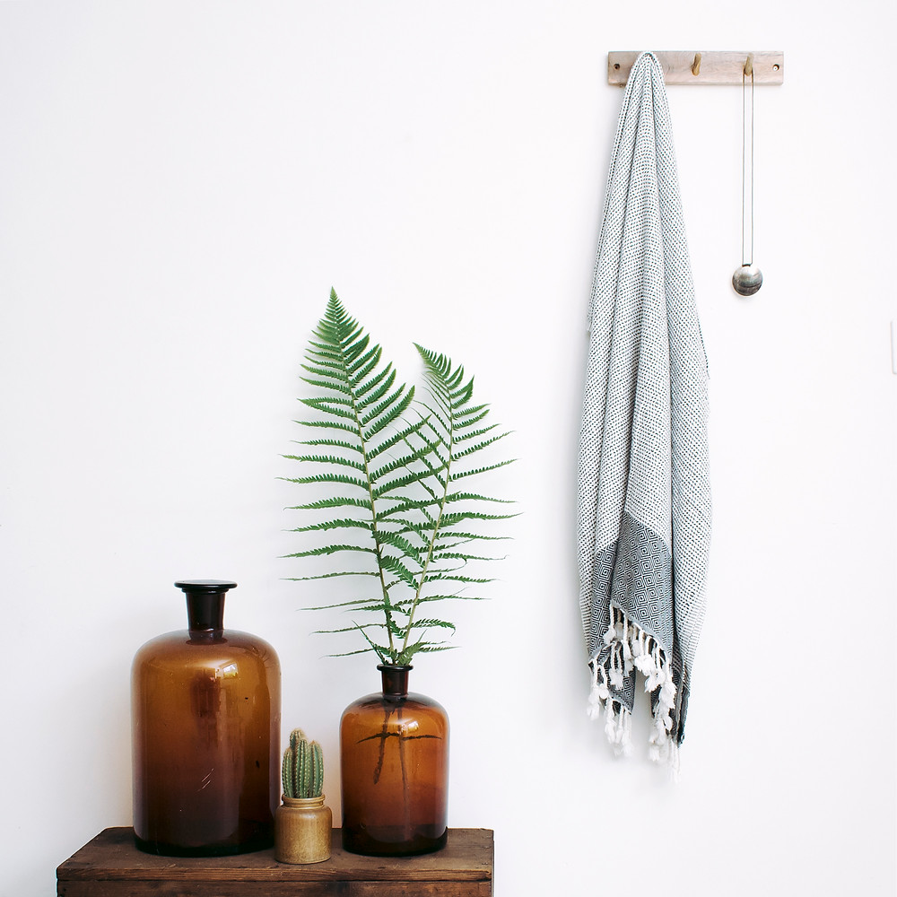 kuishi glass amber bottles and the bamboo towel featured in the sustainable collective blog