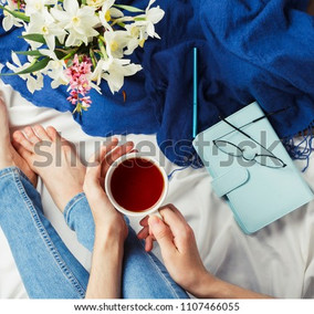 flatlay-woman-sitting-her-bed-600w-11074