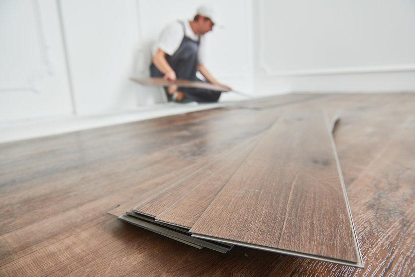 bigstock-worker-laying-vinyl-floor-cove-