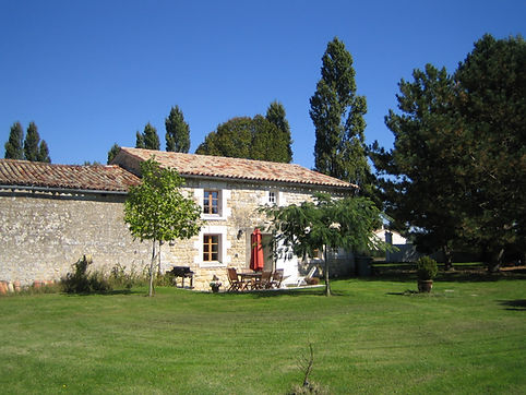 The 3 bedroomed Cottage with private patio and adjacent traditional stone barn. Le Manoir gite business for sale