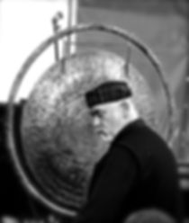 Silence In Sound, Craig Shankster playing a Singing Bowl Gong in a SoundBath