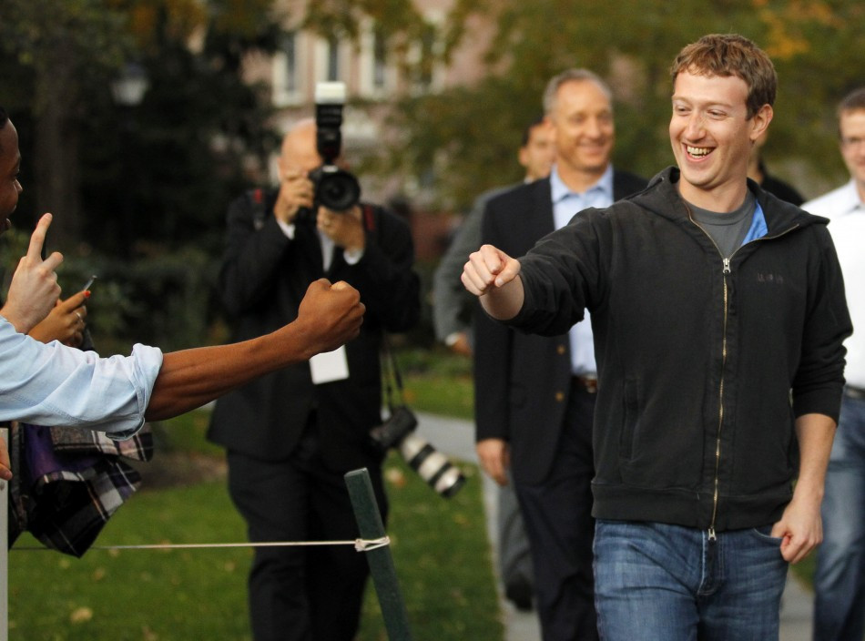 Mark Zuckerberg fistbumps student