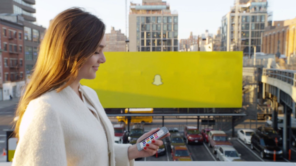 snapchat billboard with woman in foreground