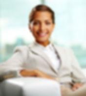 Portrait of successful female sitting in