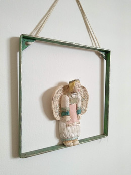Singing Angel in window frame