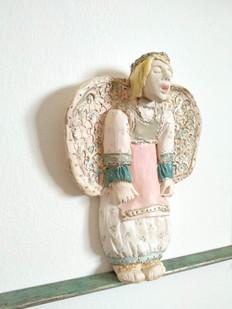 Singing angel in window frame