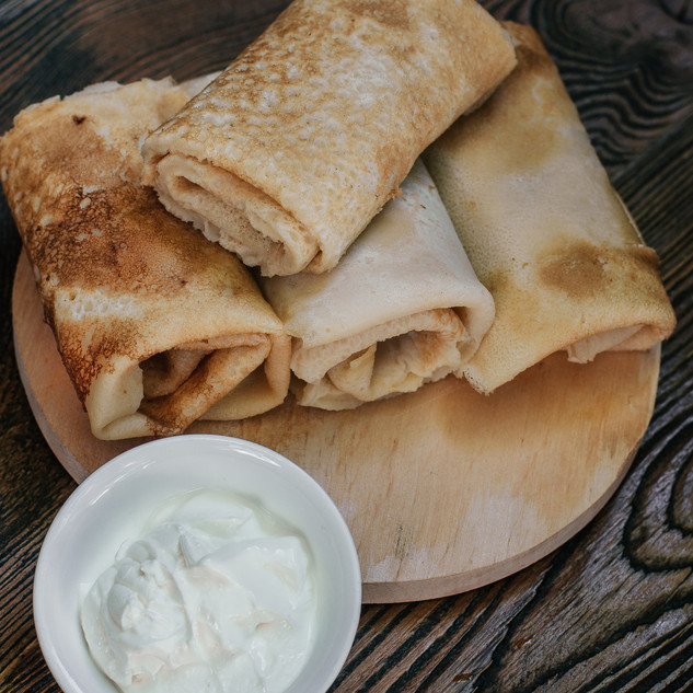 Pancakes with meat and sour cream.jpg