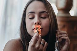 portrait-of-woman-kissing-orange-flowers