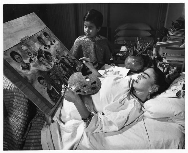 Frida Kahlo paints in bed
