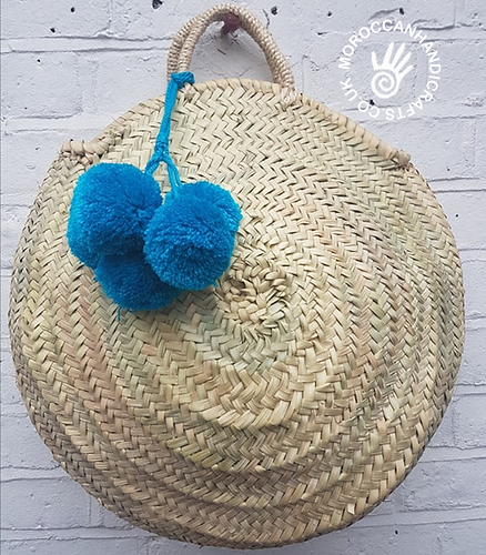 Large round French basket with bright blue pom poms - handmade