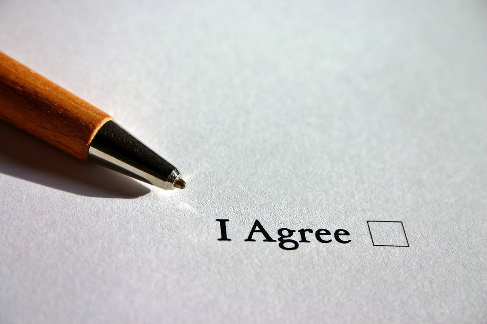 "Image of a pen about to check off a box that reads ""I agree"""