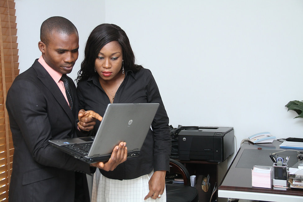 Image of two people looking a laptop