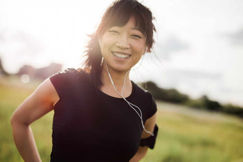 happy, smiling female post-exercise outdoors