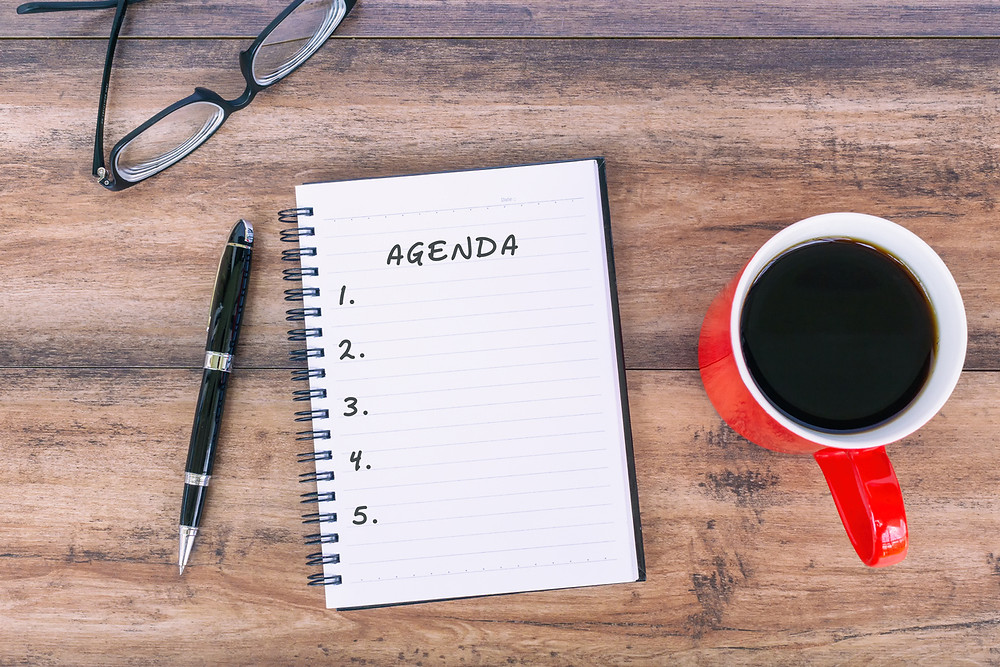 Agenda to-do list written notepad morning cup of coffee