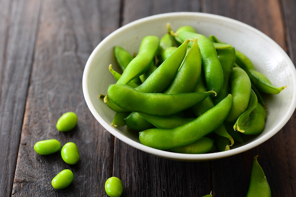 Bowl of steamed edamame, soybeans