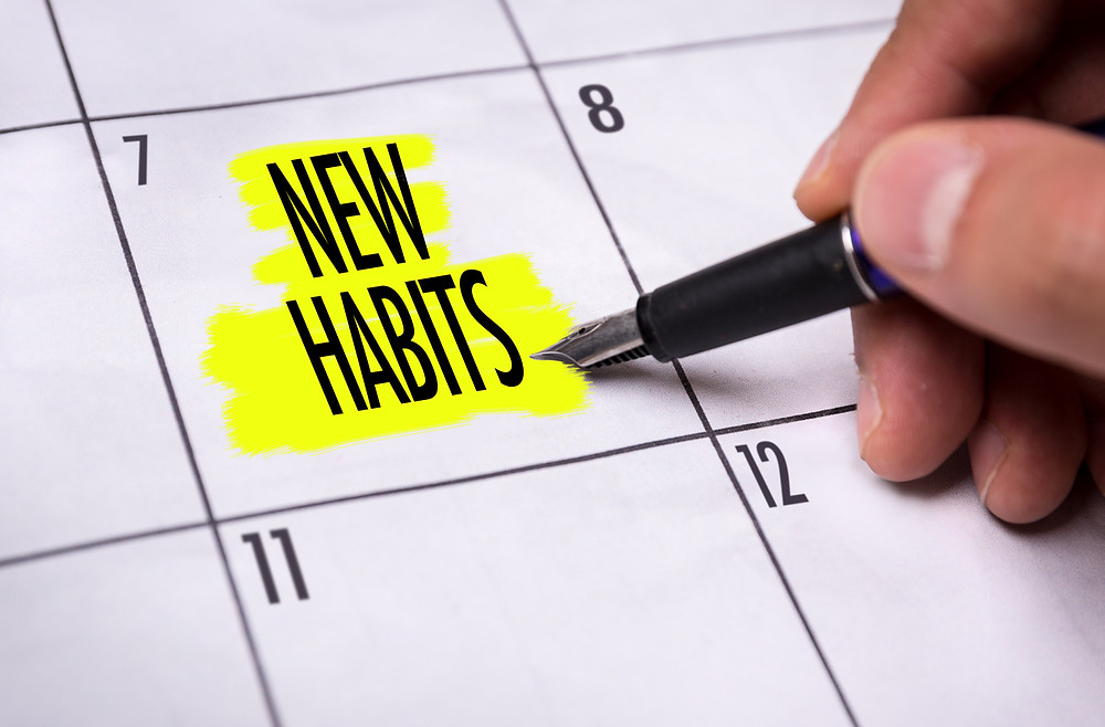 "calendar with highlighted reminder for ""new habits"" to begin"
