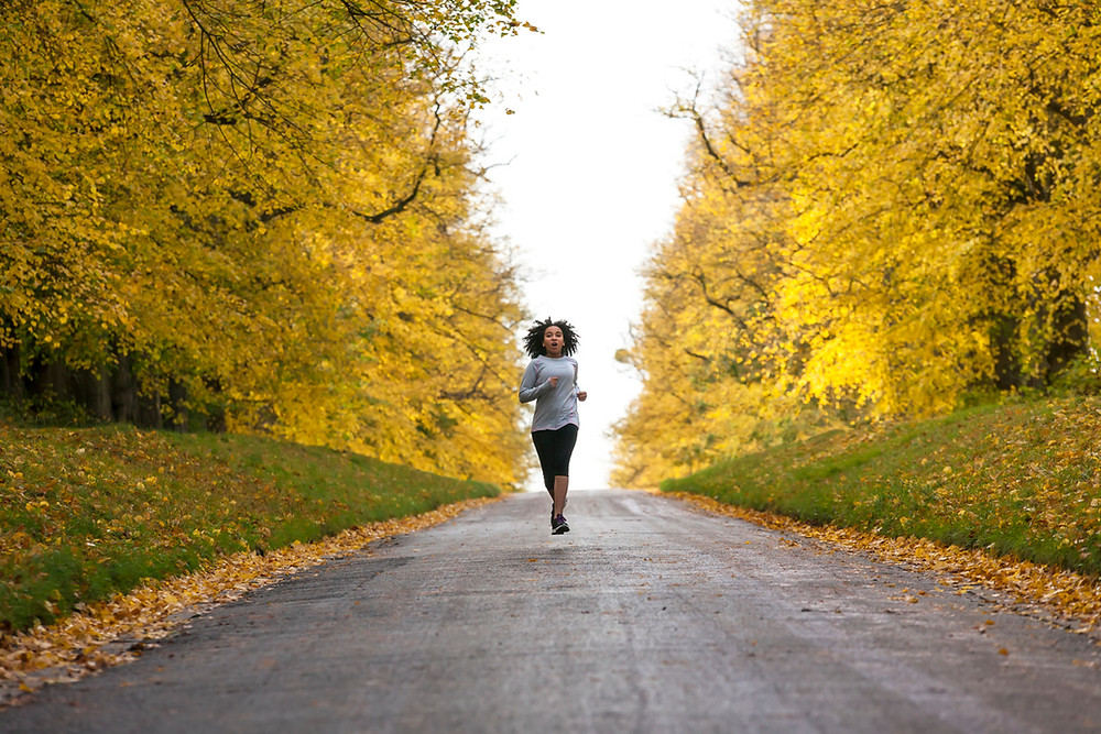 running outside in autumn, exercising during the fall