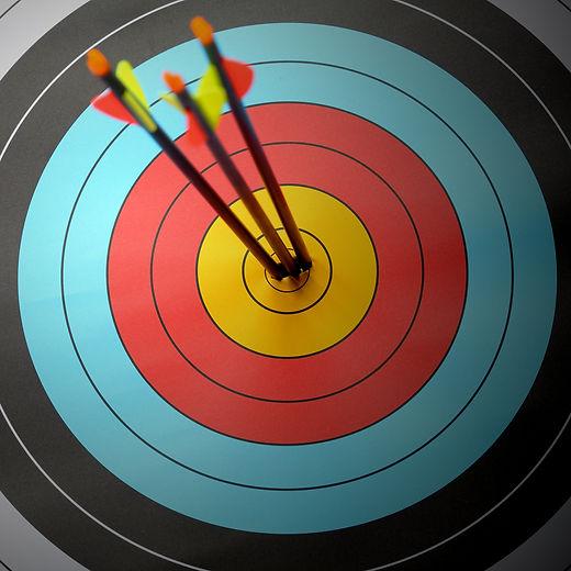 Arrow hit goal ring in archery target.jp
