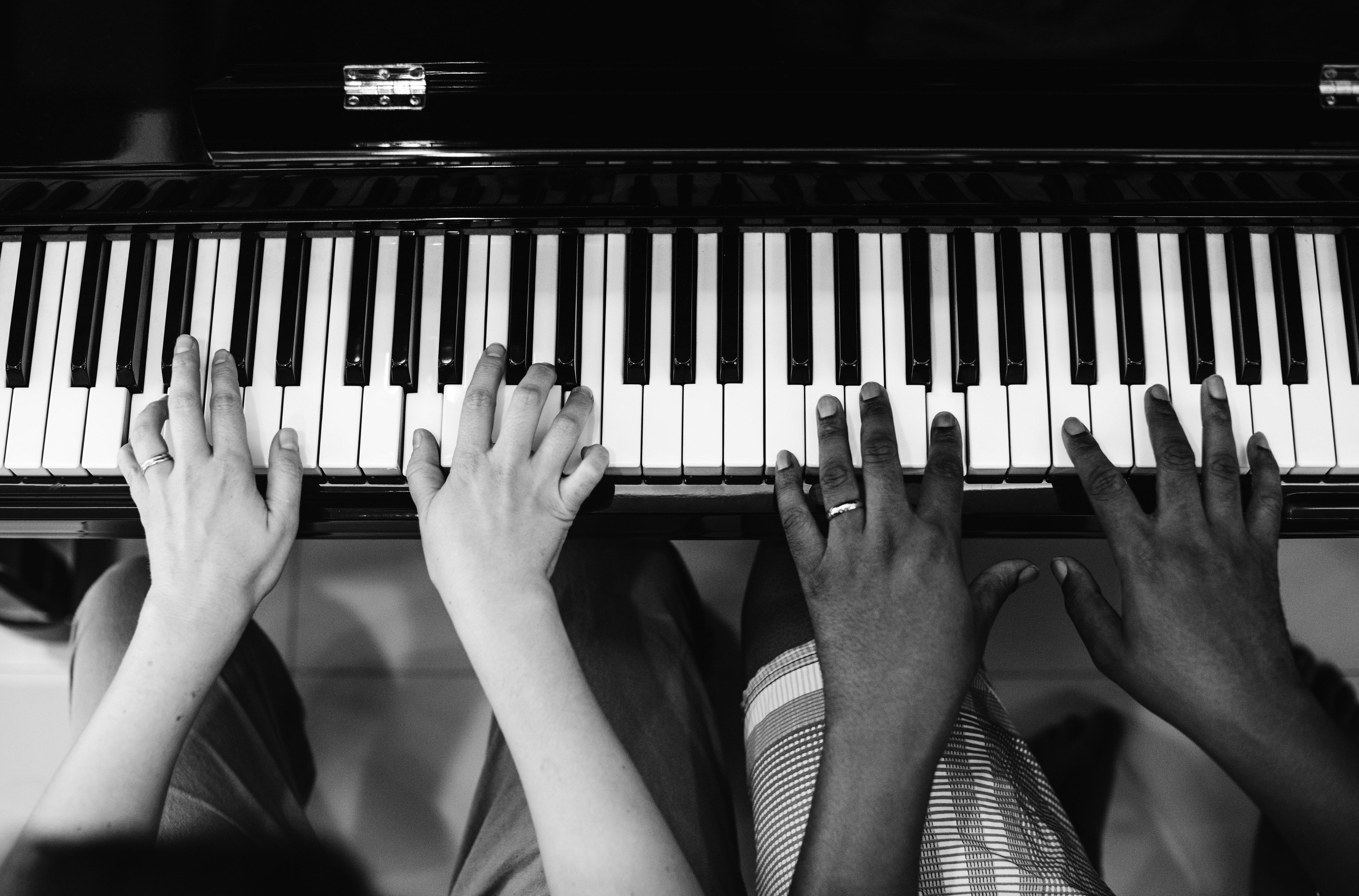 Piano teacher playing duet