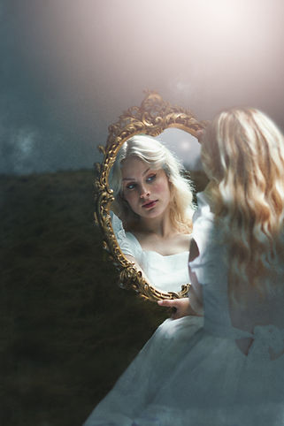 Manchester Fashion Photographer | Woman looking into mirror | Fashion Photography