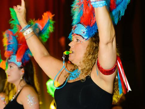 Samba dance leader directs her team
