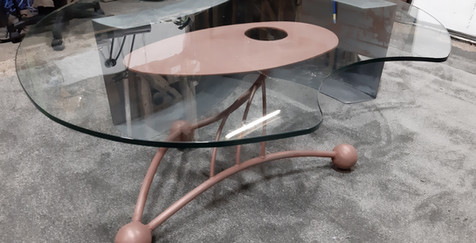 low table with cut-out glass top