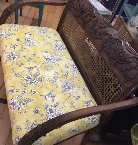 Dark wood bench upholstered