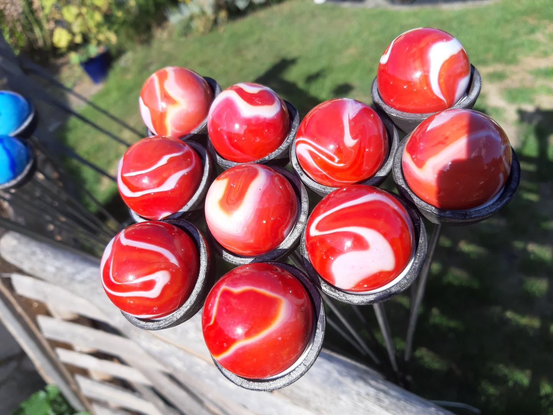 Red garden orbs at Blackthorpe Barn