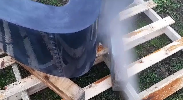 spraying the coated base of the low tabl