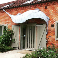 'The Whale', this whacky canopy measures roughly five metres from tip to toe. Zinc over steel.