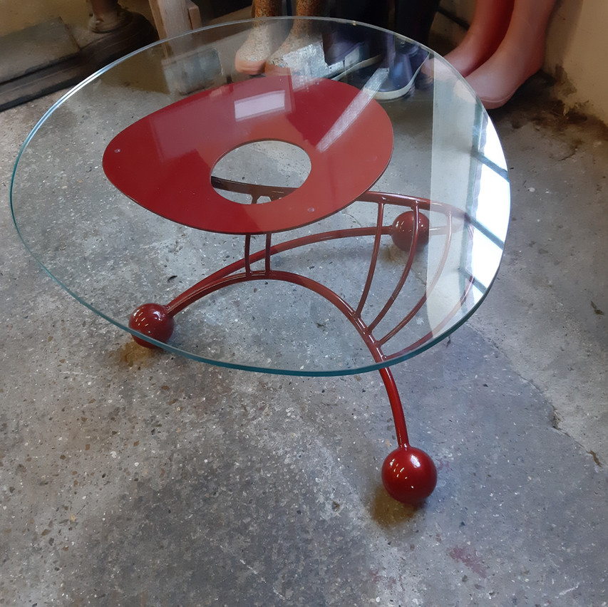 Egg-shaped glass-topped coffee table